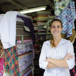 Woman standing outside fabric store
