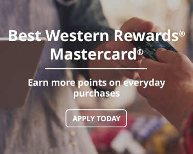 Someone using their Best Western Rewards MasterCard to pay for a purchase