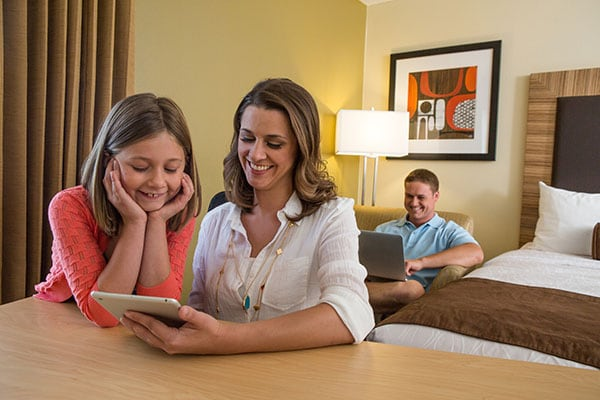 Family in room on devices